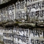 Carved mantra in mani stones